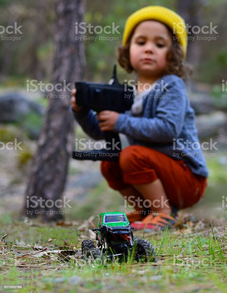 Child With Remote Control Truck - defocused stock photo