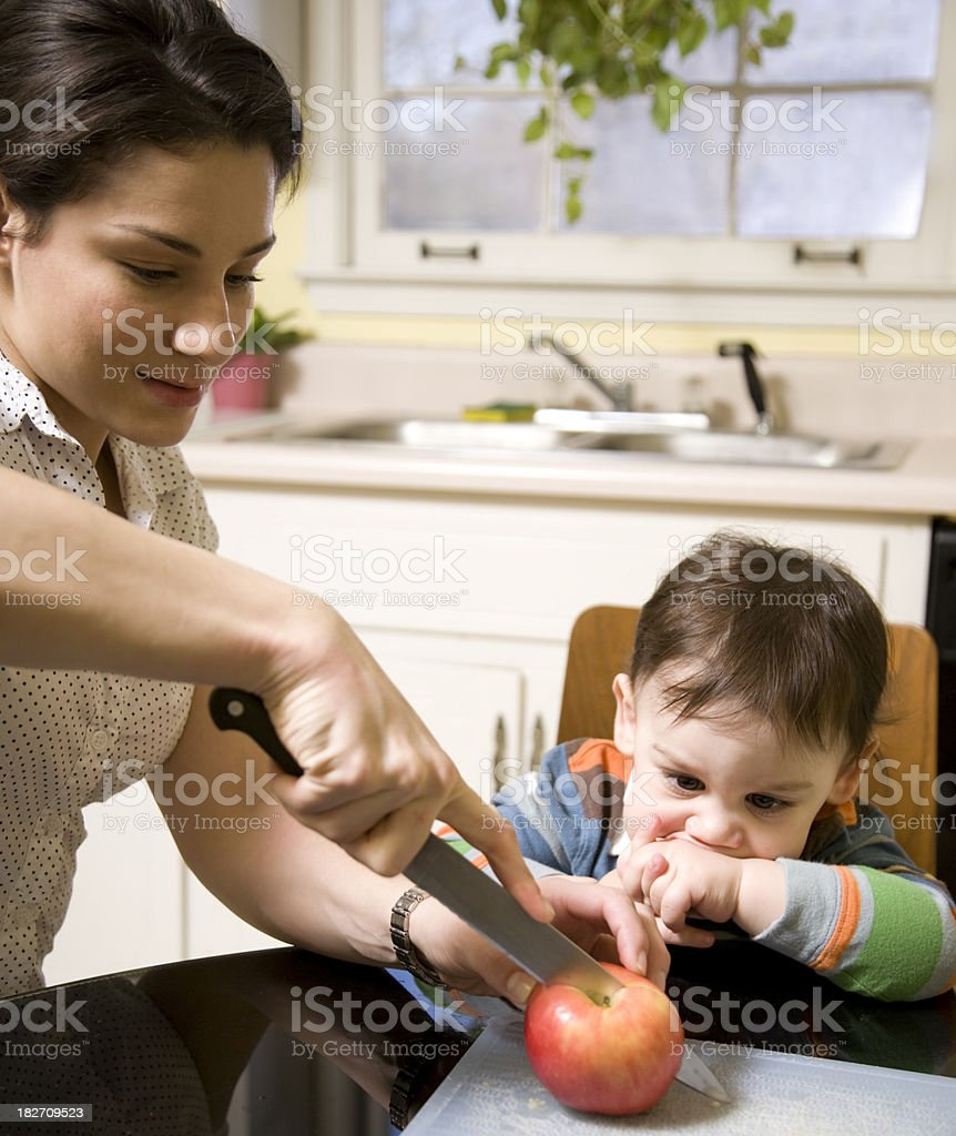 Child with sliced apples royalty-free stock photo