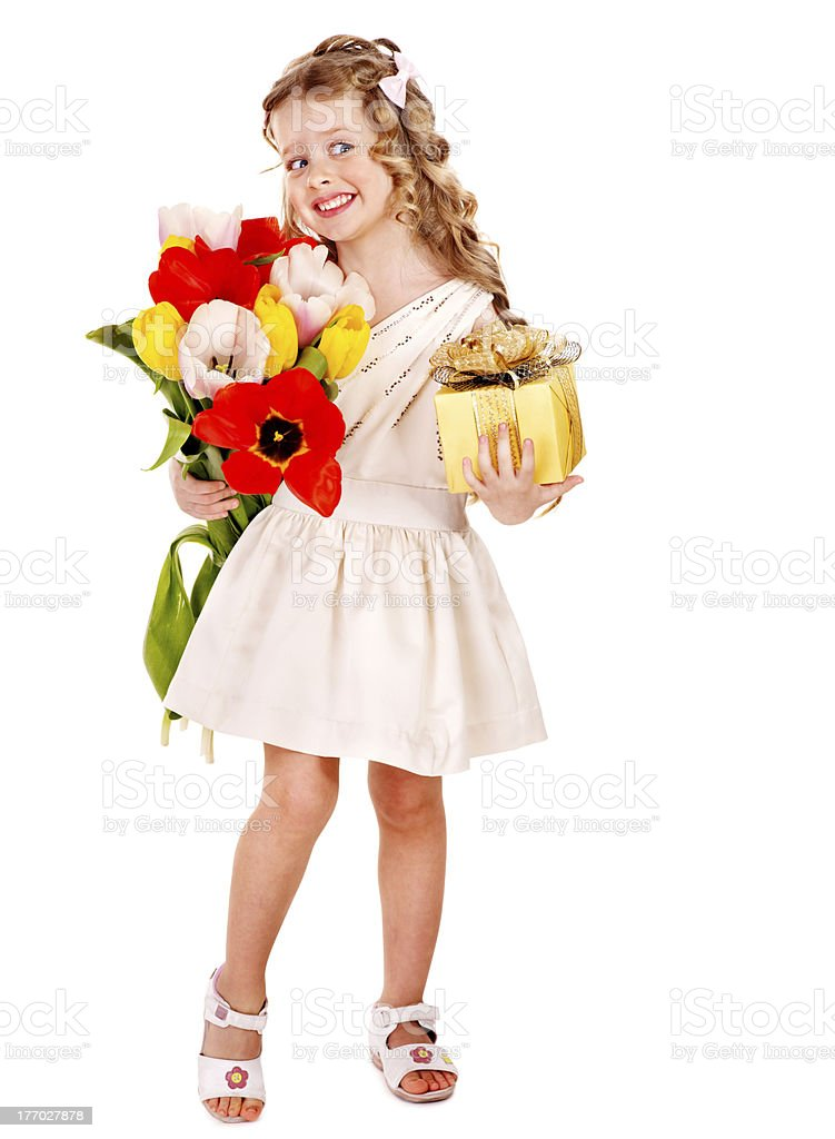 Child with spring flower and gift box. royalty-free stock photo