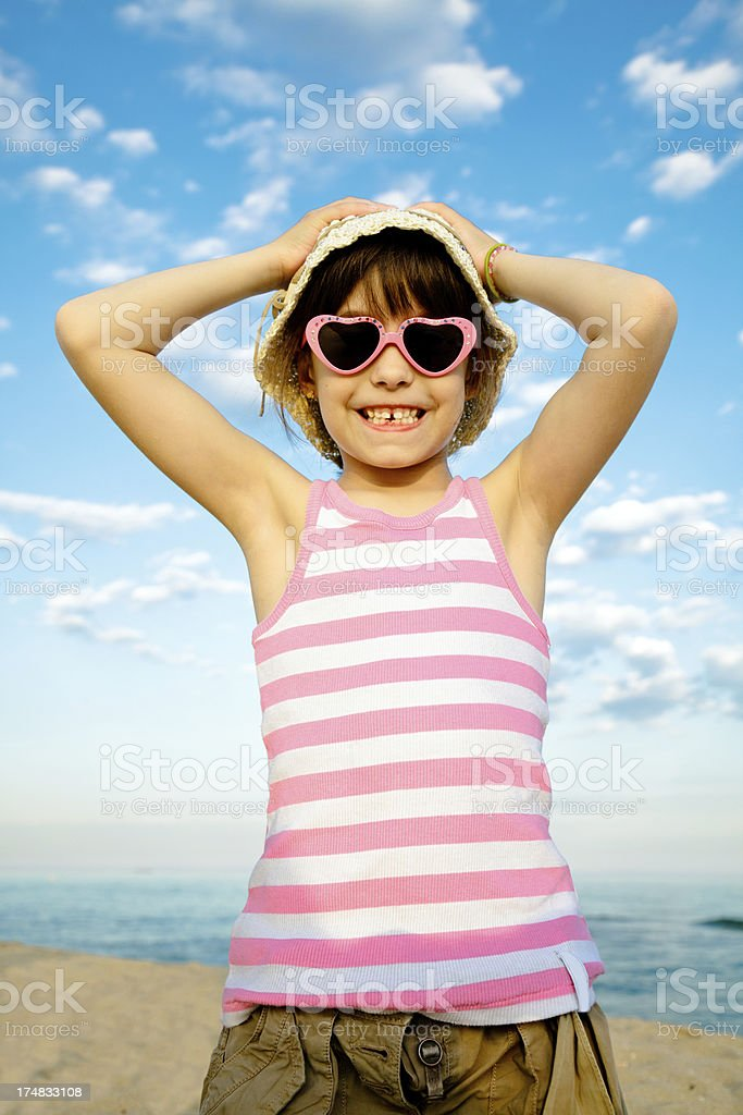 Child with sunglasses heart shaped royalty-free stock photo