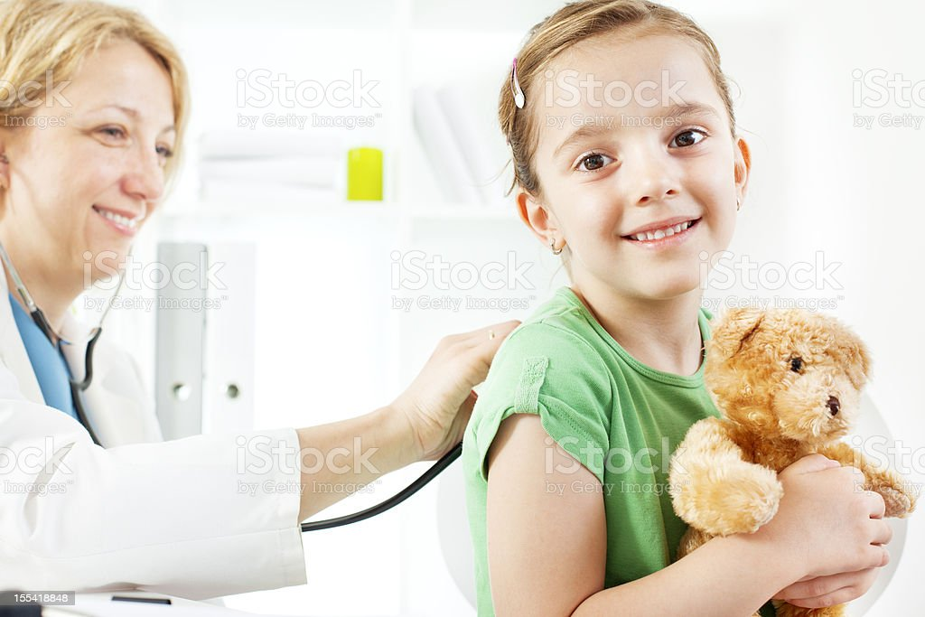 Child with teddy bear at doctors office. royalty-free stock photo