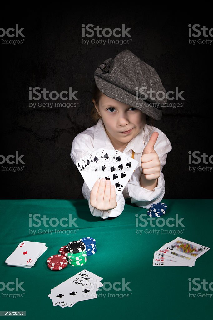 Child with the winning combination of poker stock photo