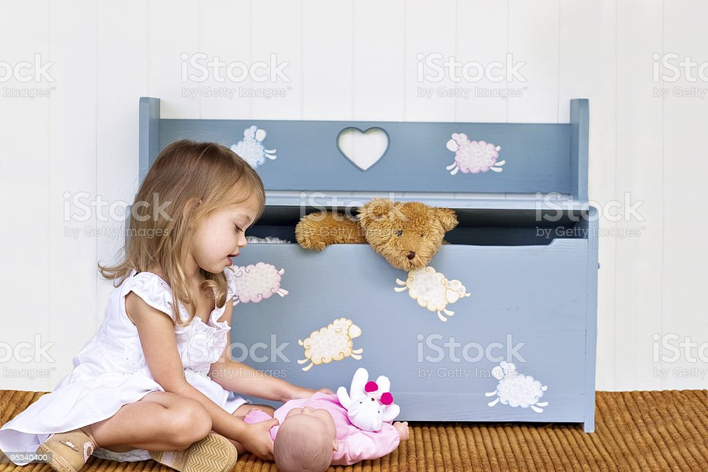 Child with toy box and toys. royalty-free stock photo
