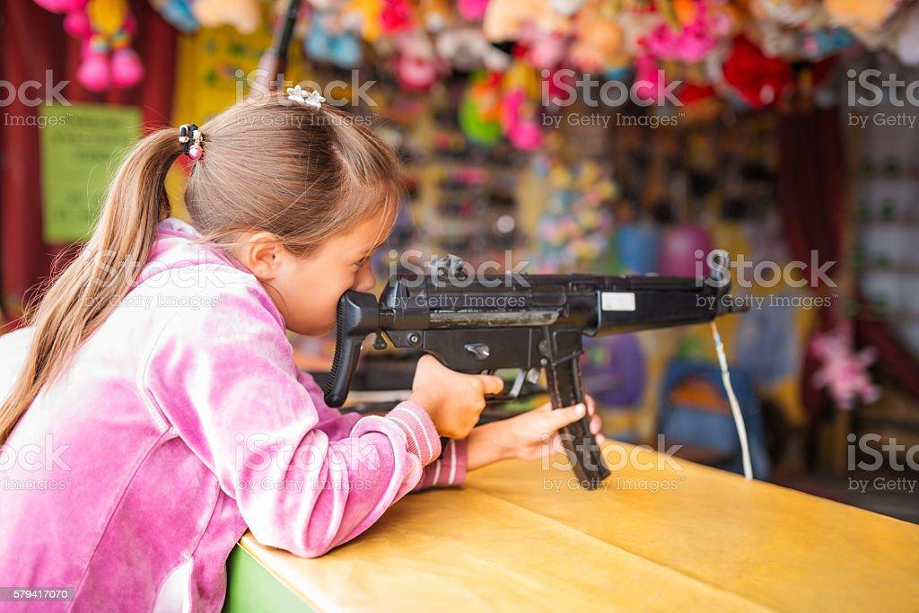 Child with toy gun stock photo