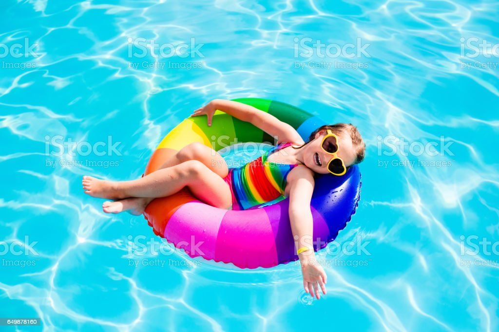 Child with toy ring in swimming pool stock photo