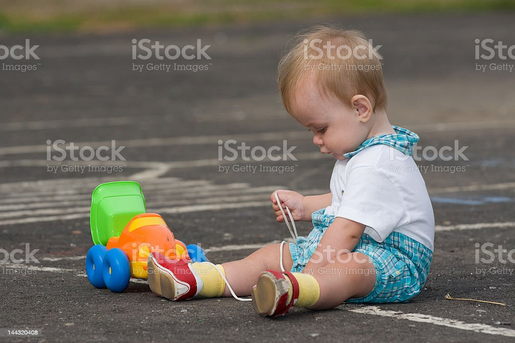 Child with toy truck playing on road royalty-free stock photo