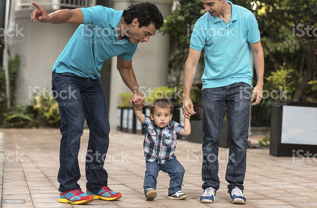 Child with two dads royalty-free stock photo