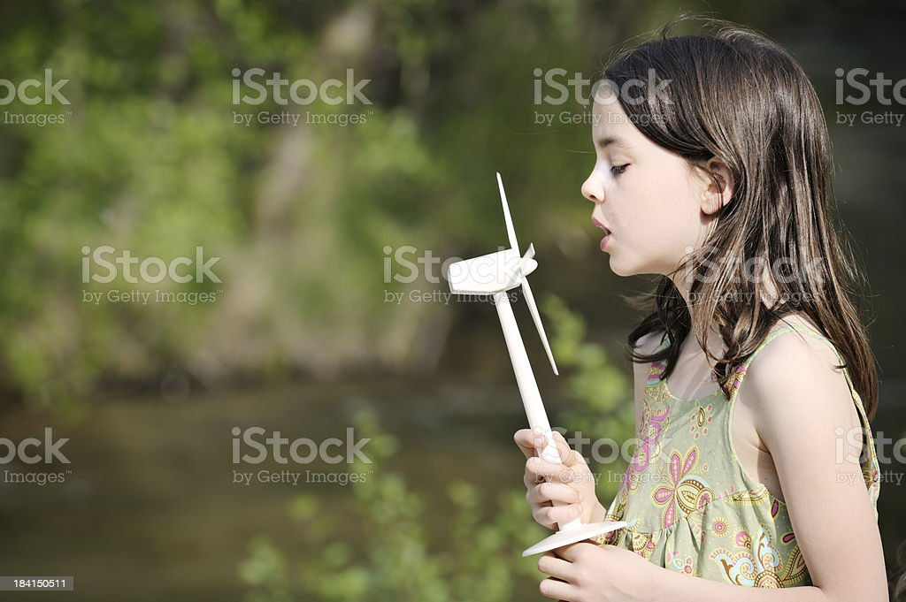 Child with wind and water power stock photo