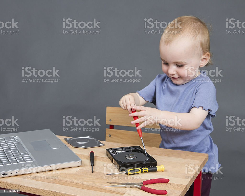 child working at open hard drive royalty-free stock photo