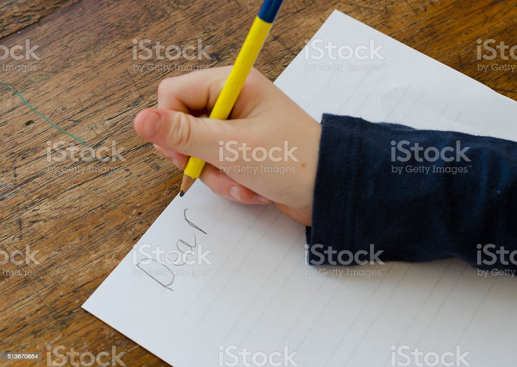 Child writing a letter stock photo