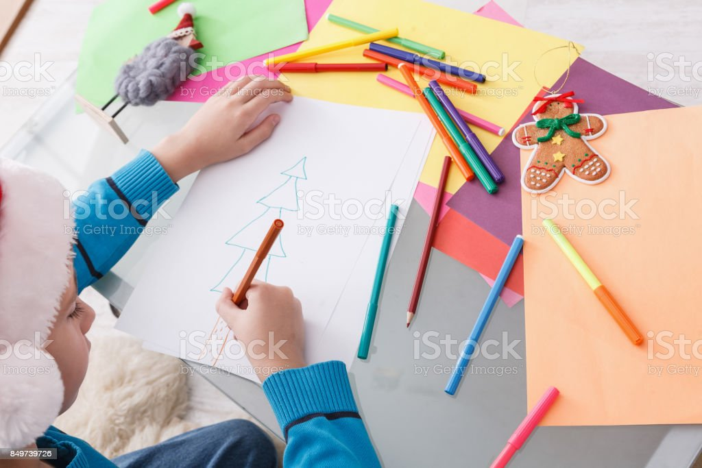 Child writing letter to santa, wait for christmas, top view stock photo