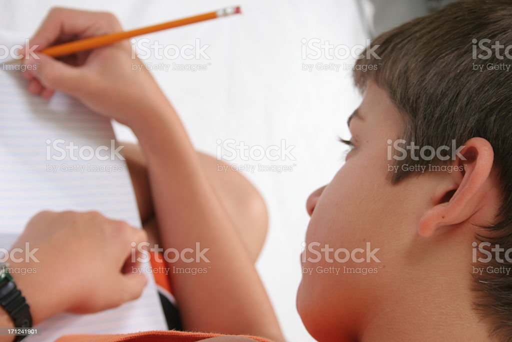 Child writing with pencil royalty-free stock photo
