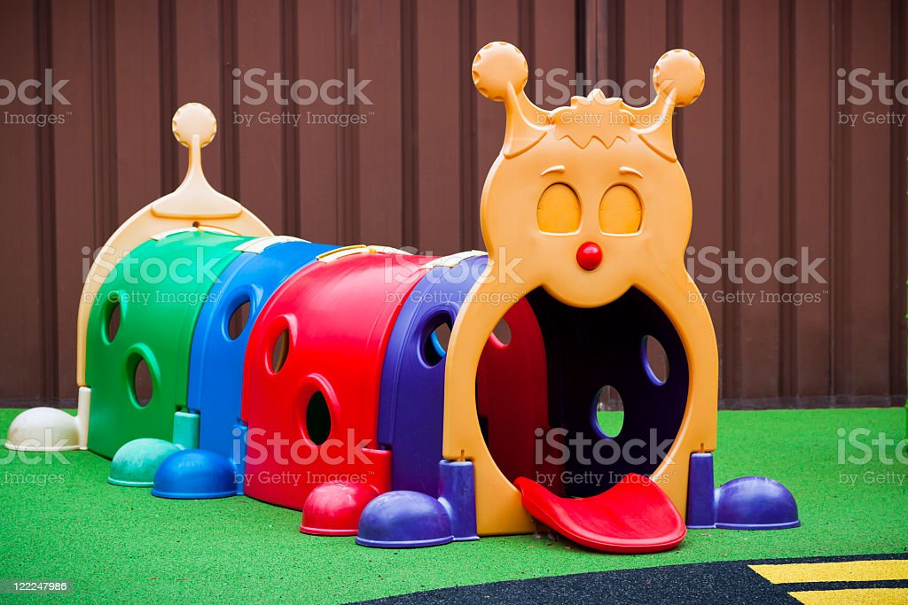 Childcare playground with colourful caterpillar stock photo