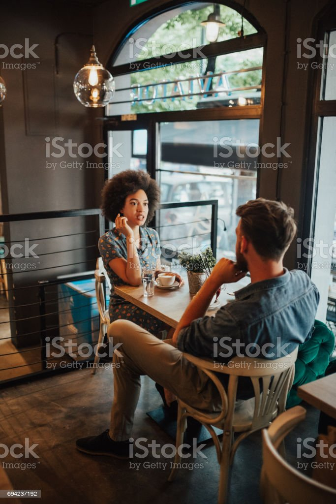 Childhood friends sat down to drink coffee stock photo