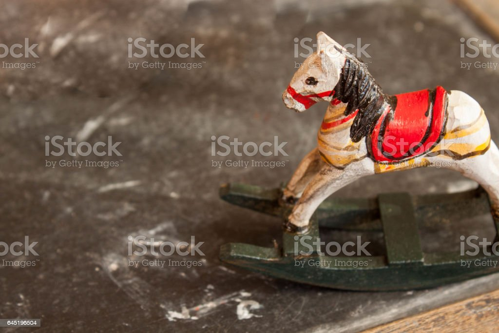 childhood memories , old school stone board and horse toy stock photo