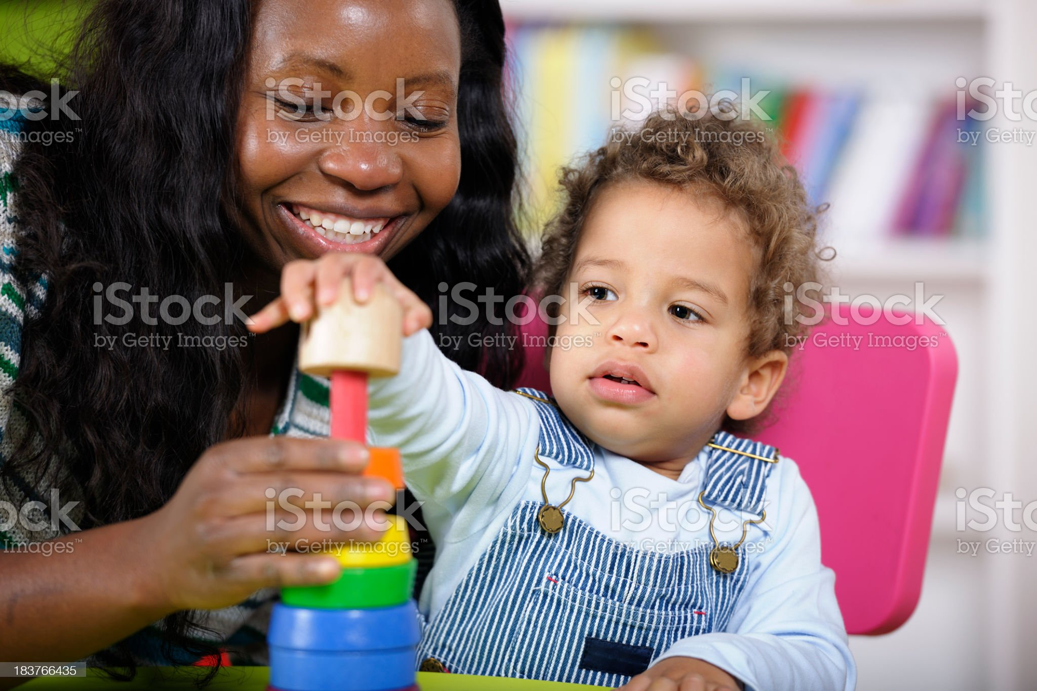 Childminder And Toddler Playing With Multi-coloured Rings royalty-free stock photo