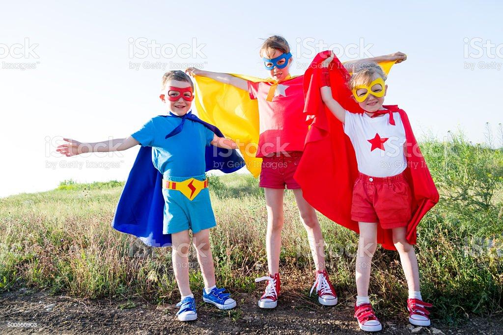 children  acting like a super hero stock photo