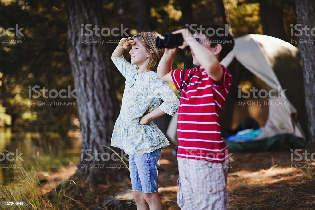 Children admiring view at campsite stock photo