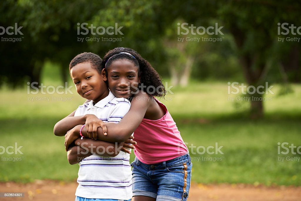 children african boy and girl in love hugging stock photo