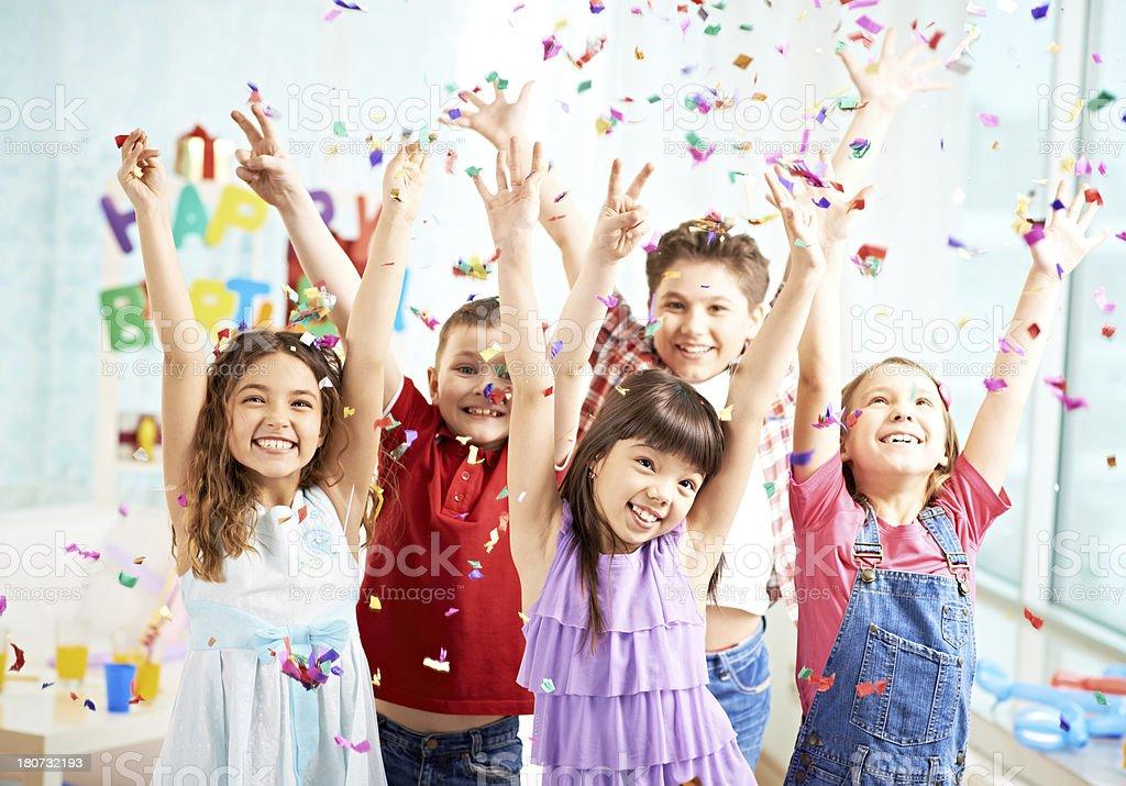 Children among confetti stock photo