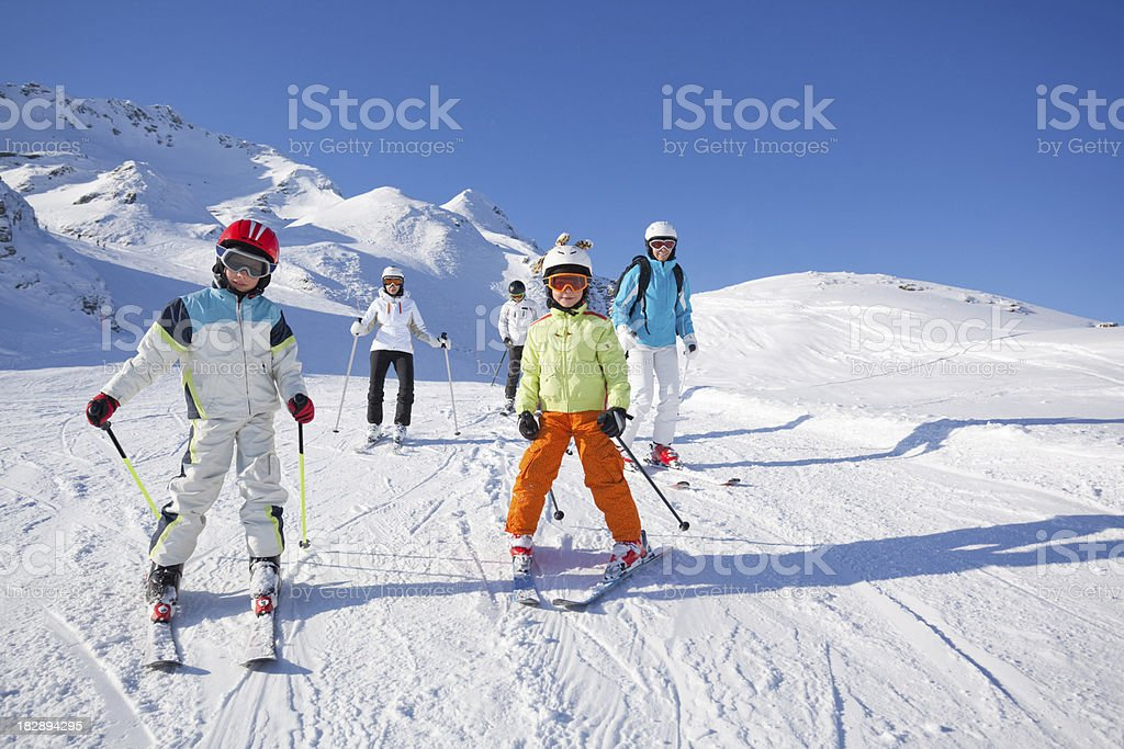 children and adults skiing on piste royalty-free stock photo
