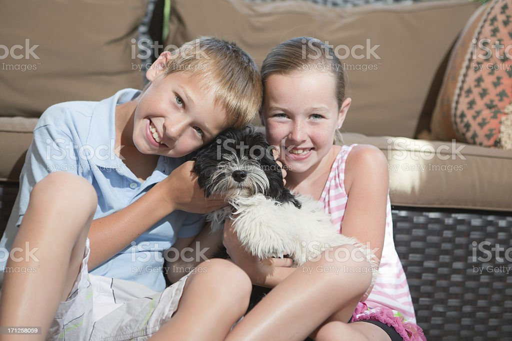 Children and Family Pet Dog Playing in the Porch royalty-free stock photo