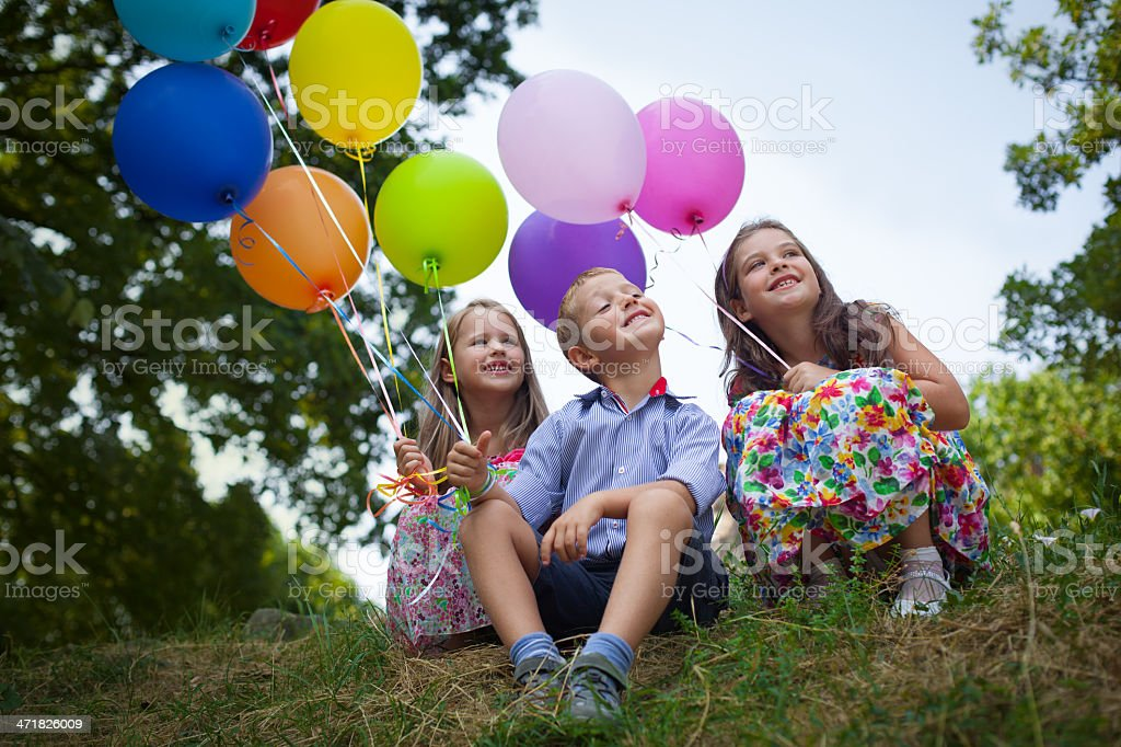Children and multicolored balloons royalty-free stock photo