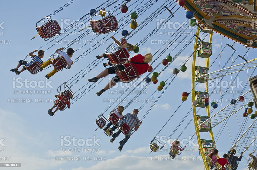 Children and Parents enjoy riding a Chairoplane at the Fair royalty-free stock photo