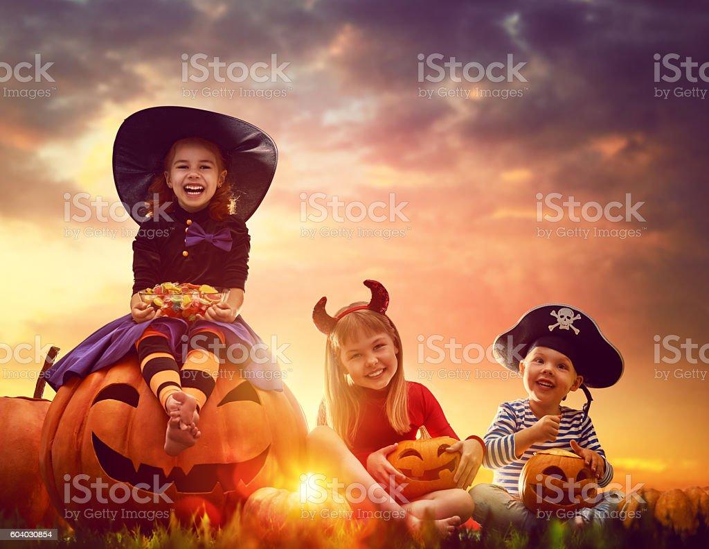 children and pumpkins on Halloween stock photo