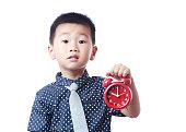 Children and red alarm clock