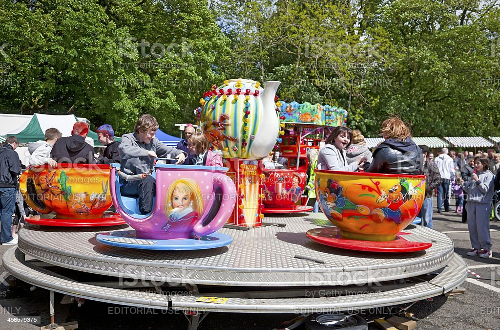 Children and teenagers on a teacups funfair ride stock photo