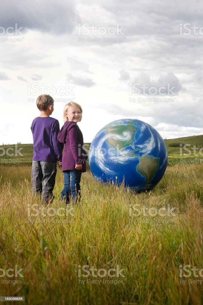 Children and the earth stock photo