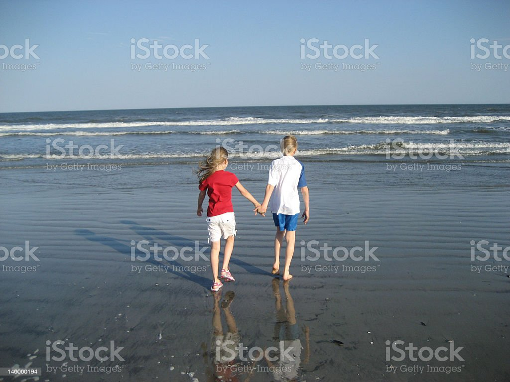 Children and the waves royalty-free stock photo