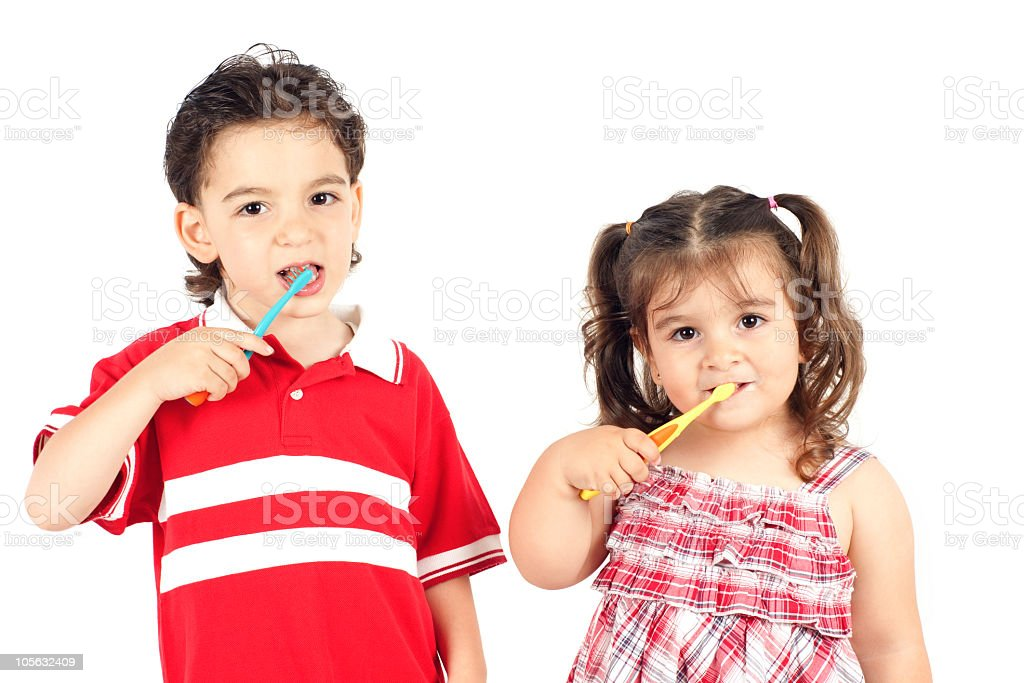 children are brushing their teeth stock photo