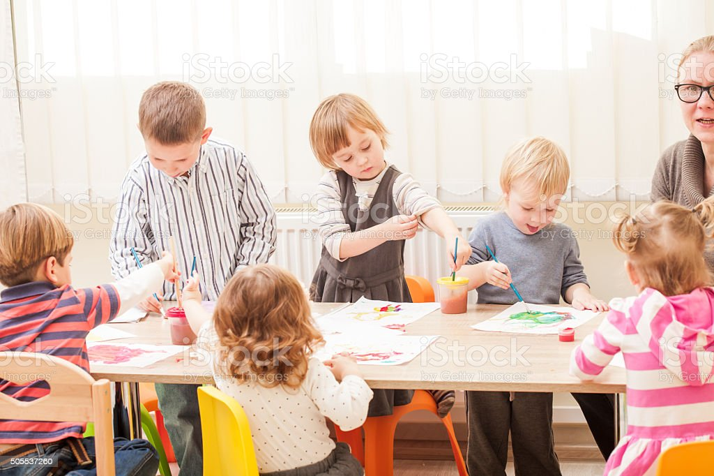 Children are painting stock photo