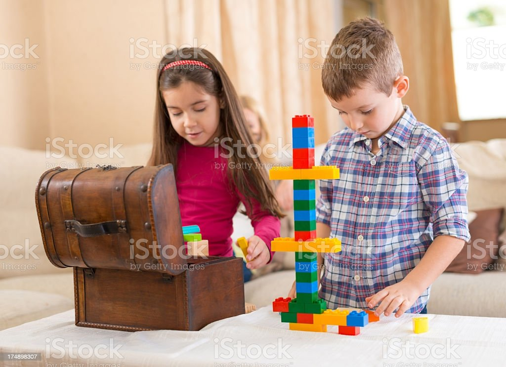 Children are playing with building blocks. royalty-free stock photo