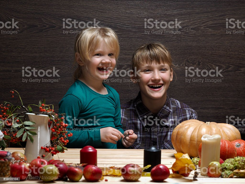 Children are prepared to meet the autumn holiday Halloween. Two...