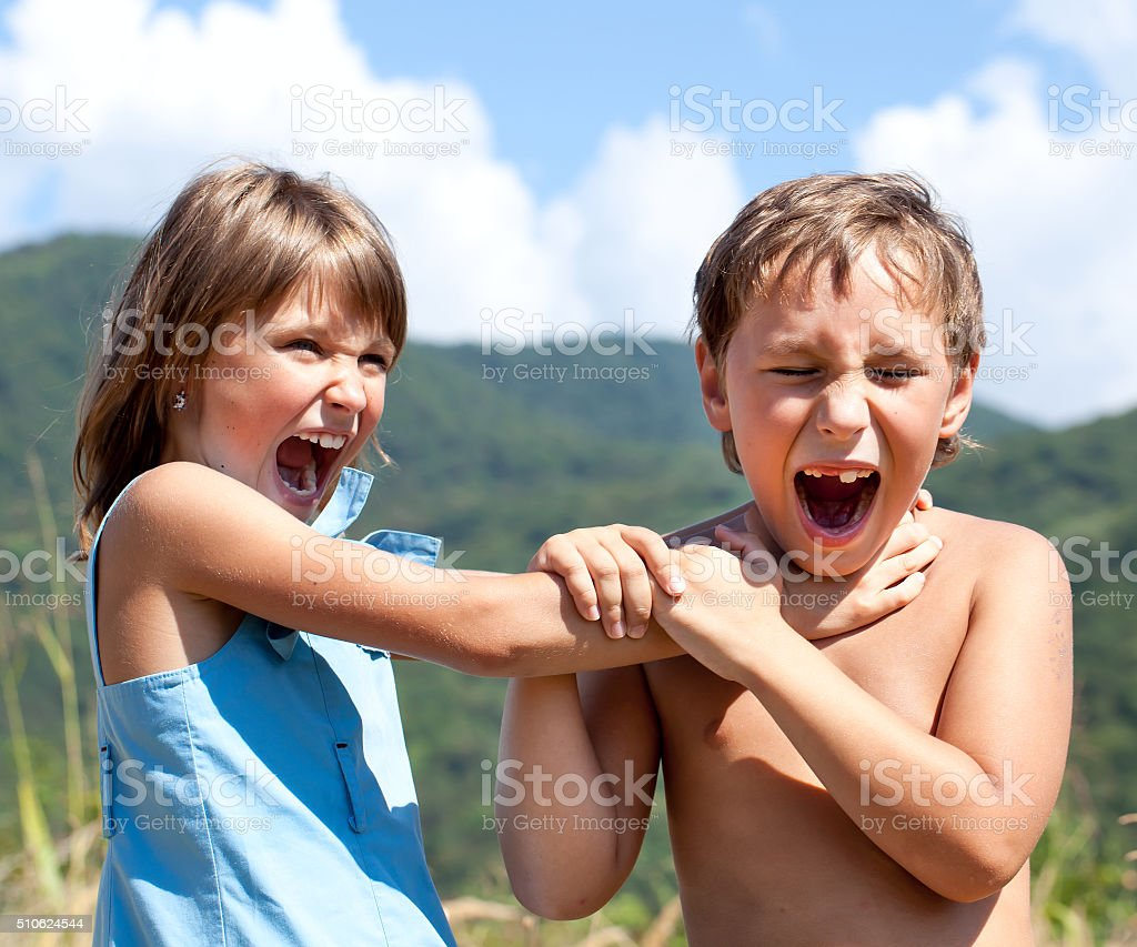 Children are swearing to each other stock photo