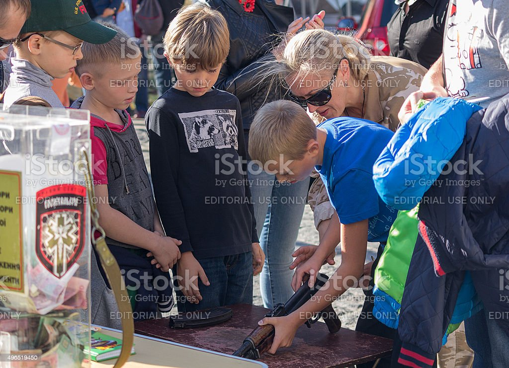Children are taught to handle weapons stock photo