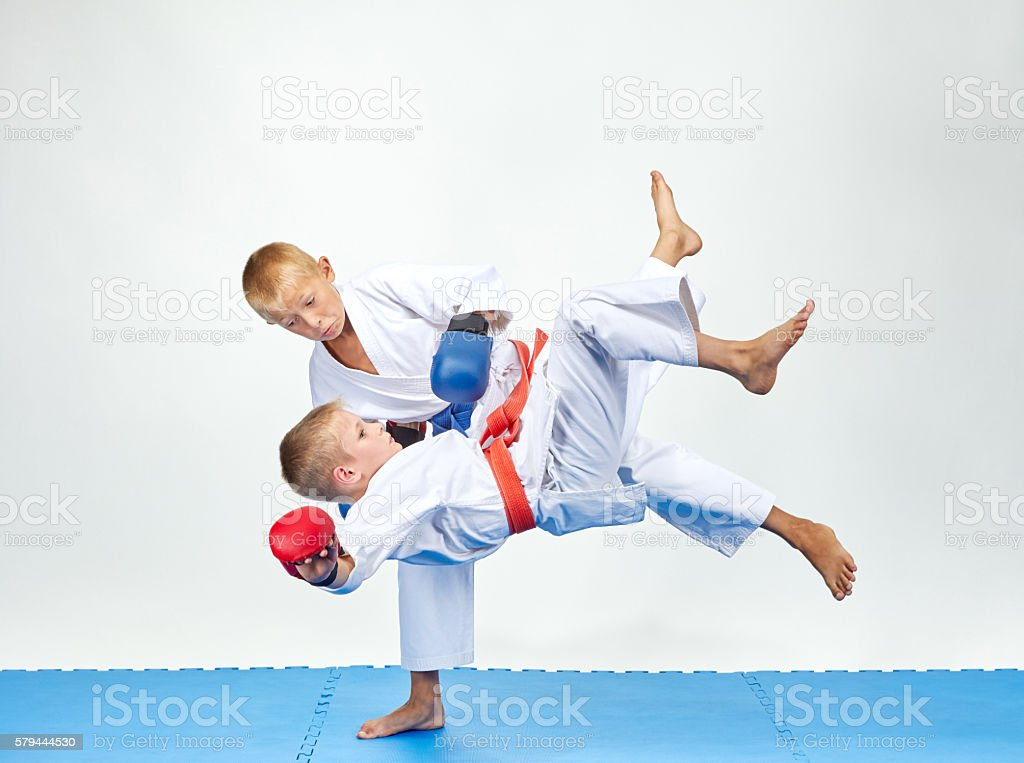 Children are training throws on a blue mats stock photo