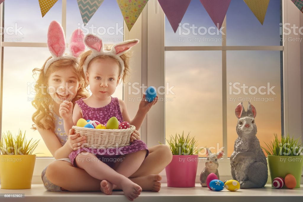 children are wearing bunny ears stock photo