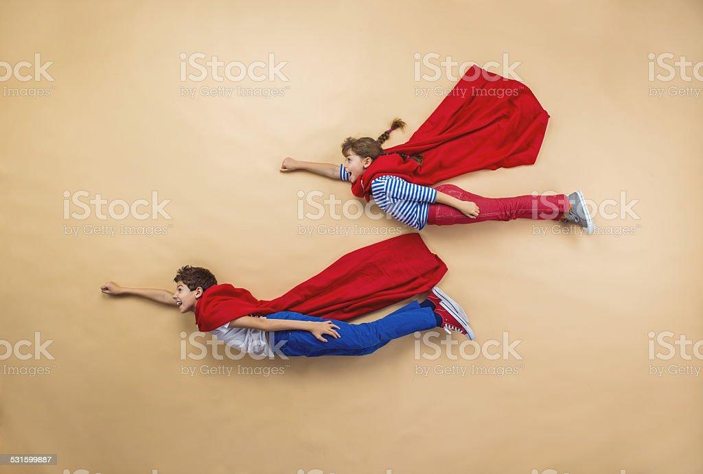 Children as superheroes stock photo