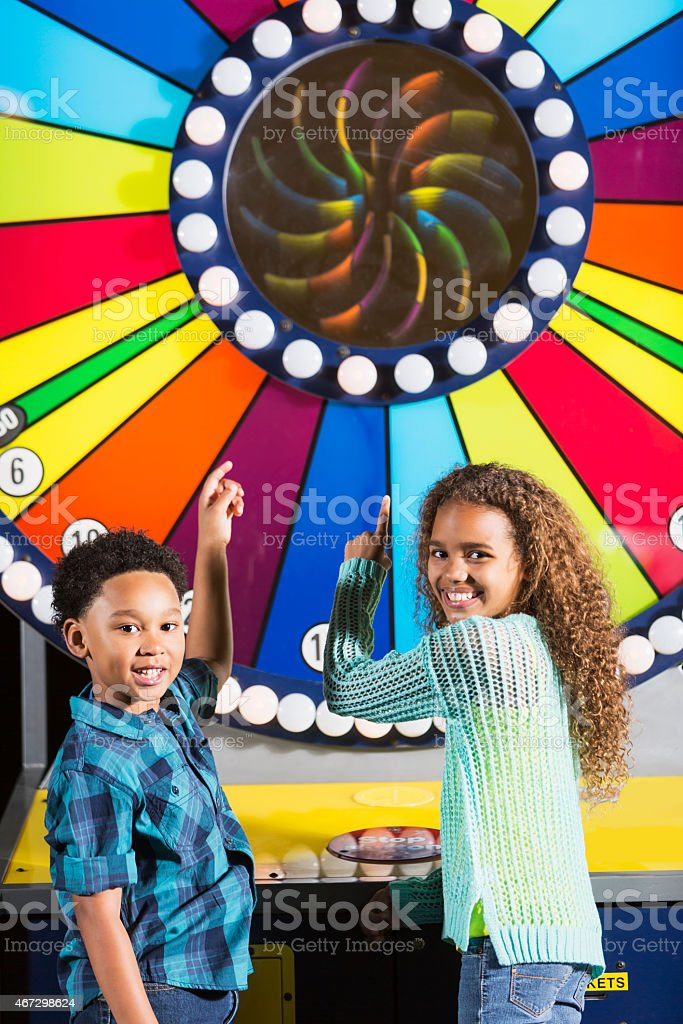 Children at an amusement arcade stock photo