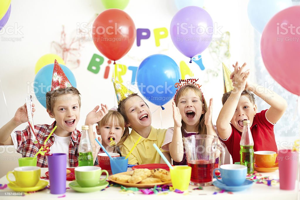 Children at birthday party with colorful balloons stock photo