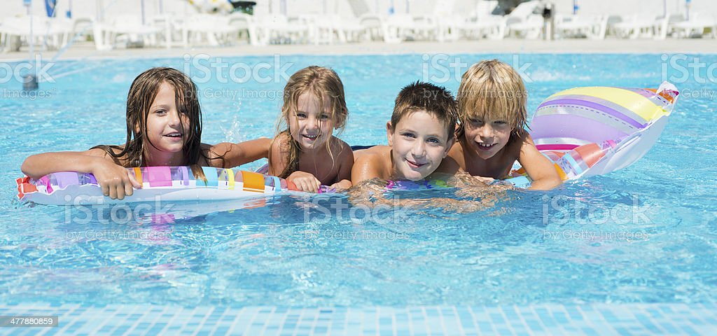 Children at swimming pool royalty-free stock photo
