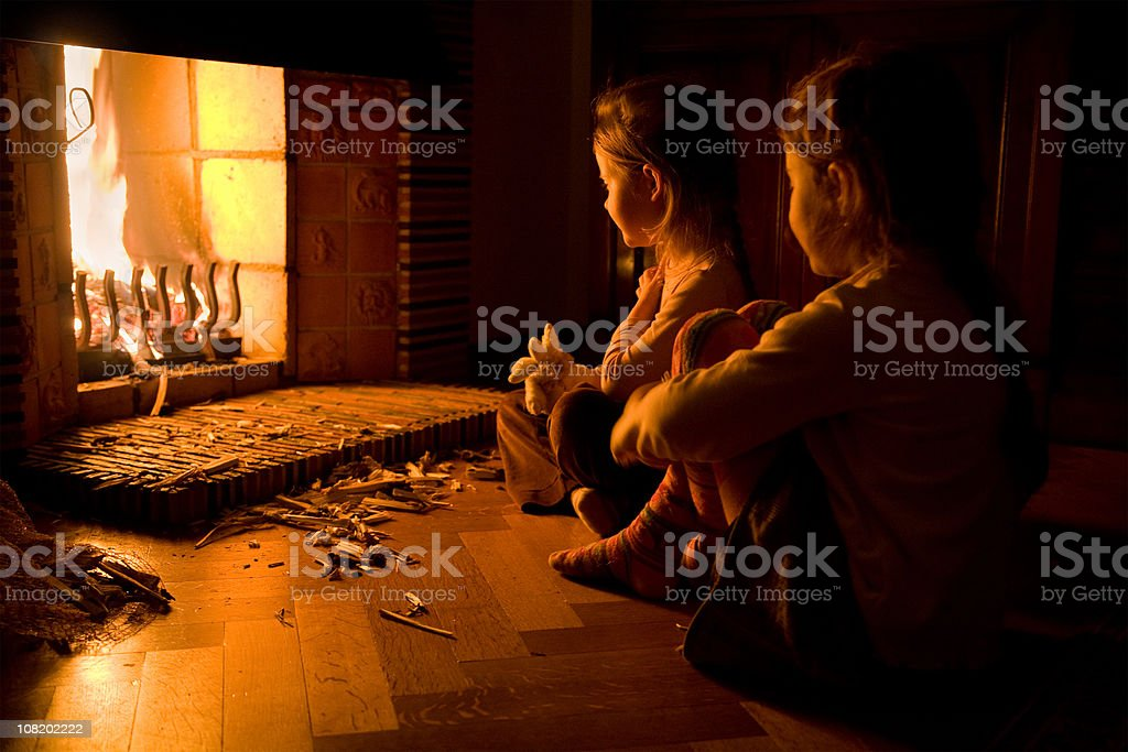 Children at the fireplace royalty-free stock photo