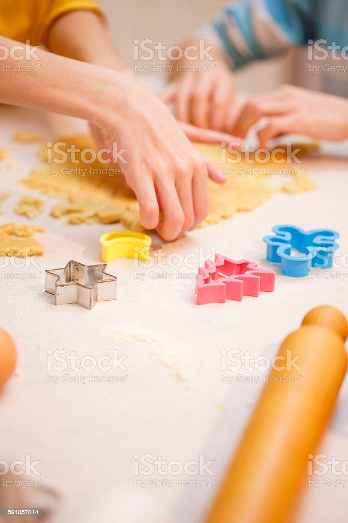 Children baking Christmas cookies stock photo