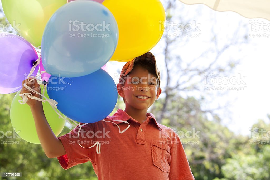 Children: balloon boy with colorful party balloons royalty-free stock photo