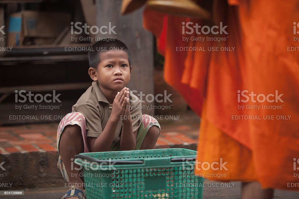 children begging during the procession of local monks stock photo
