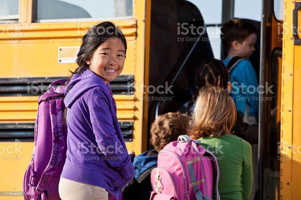 Children boarding school bus royalty-free stock photo
